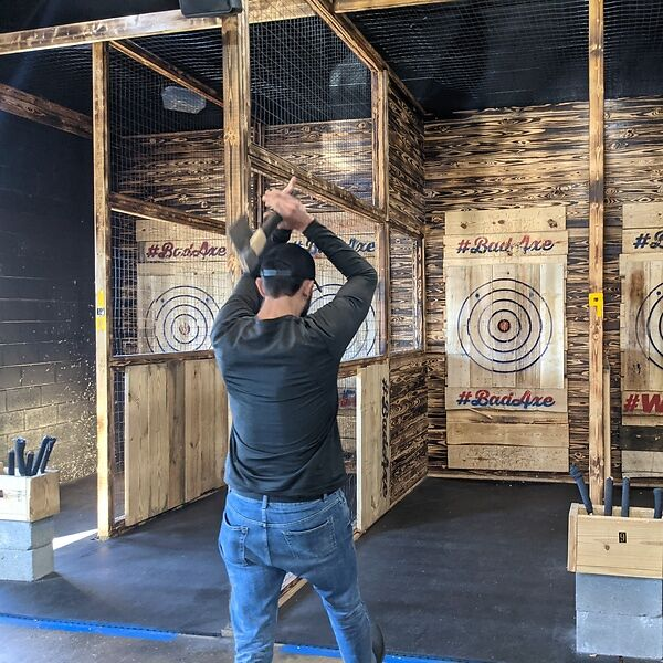 axe-throwing is a natural cousin of darts and bowling